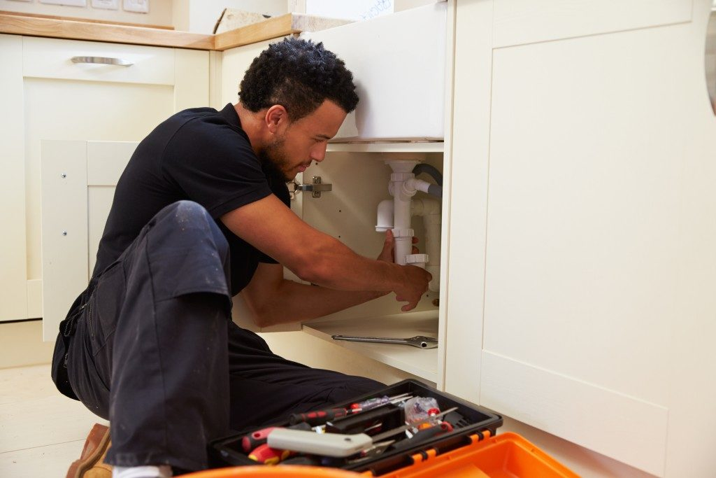 Man attending to the plumbing issues of his house