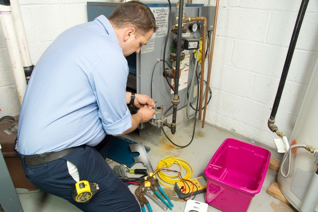 maintenance man checking furnace