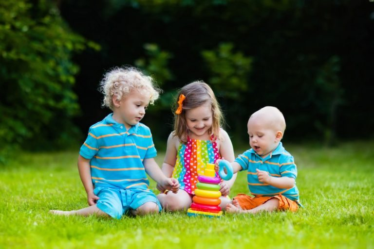 Kids playing with toys on the grass