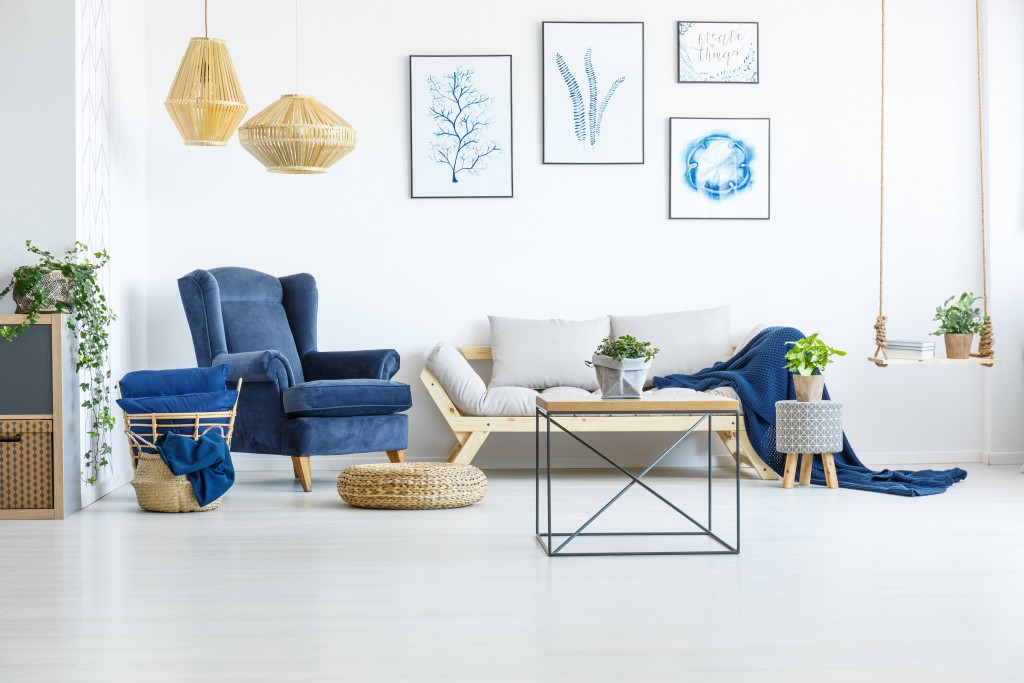living room in white and blue interiors and tile flooring