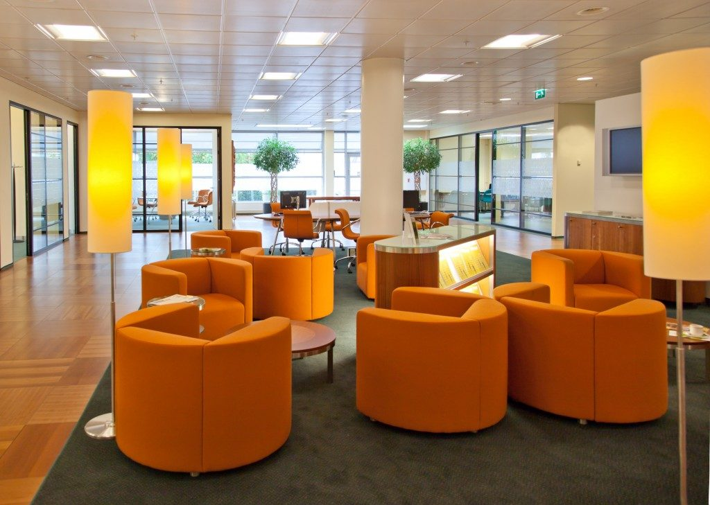 well lit office lounge in shades of orange