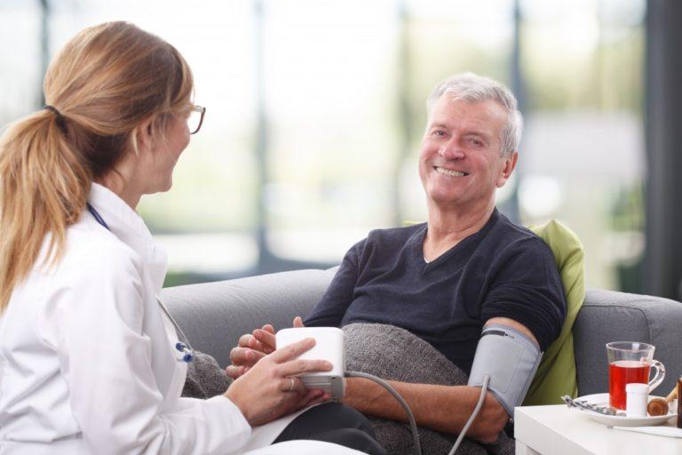 Elderly having his blood pressure checked