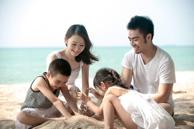 family enjoying their vacation in the beach