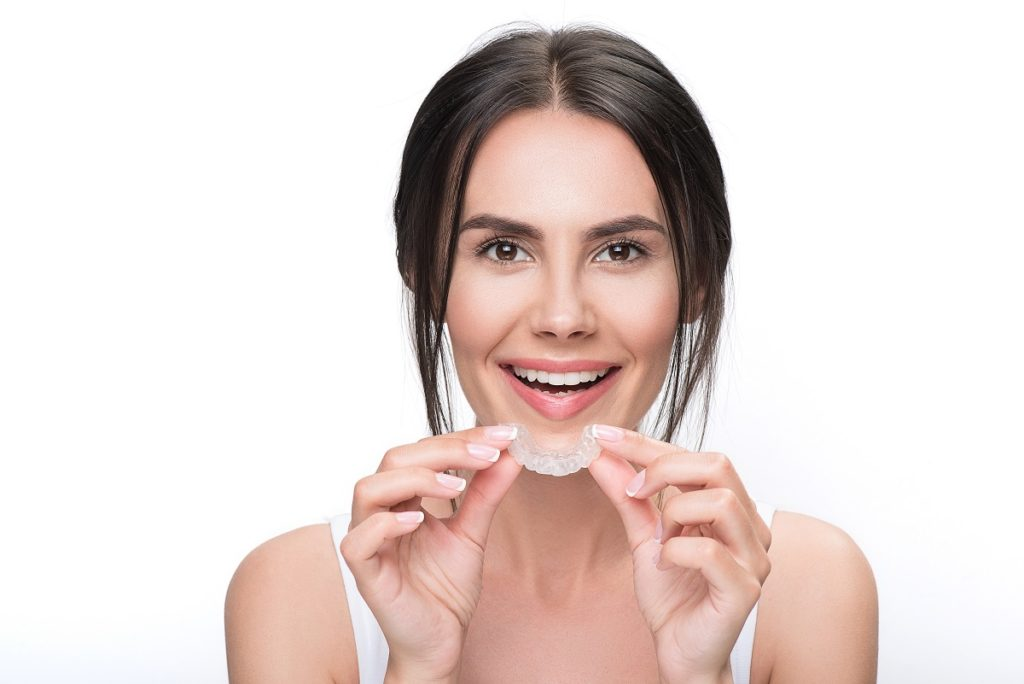 woman holding an invisible braces