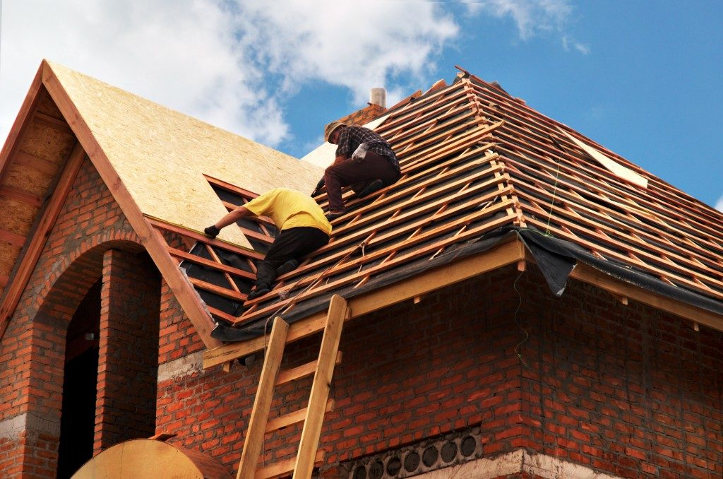 construction workers roof repair