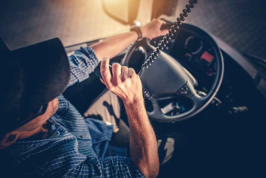 Truck driver talking to someone