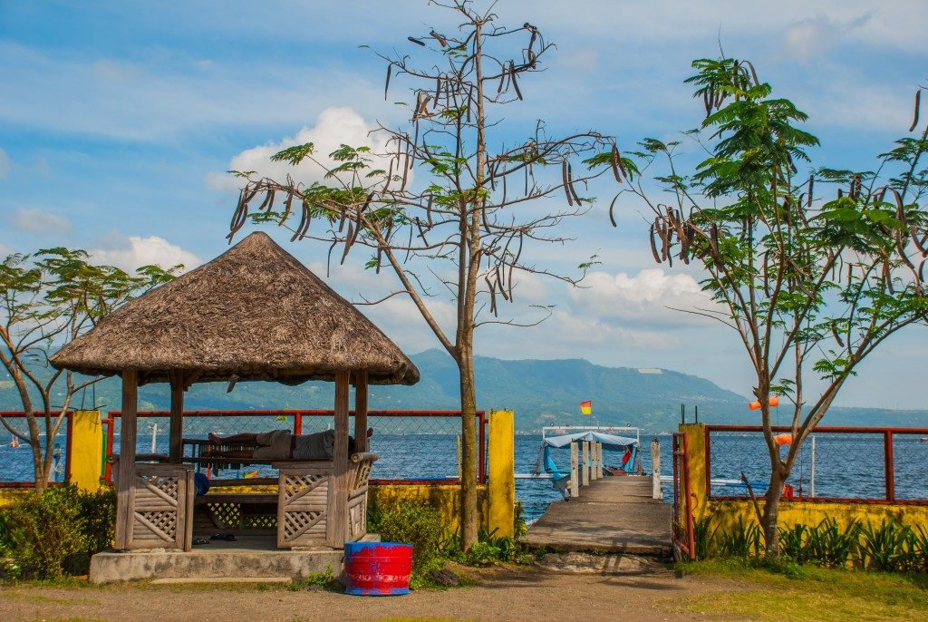 view of the sea with a nipa hut