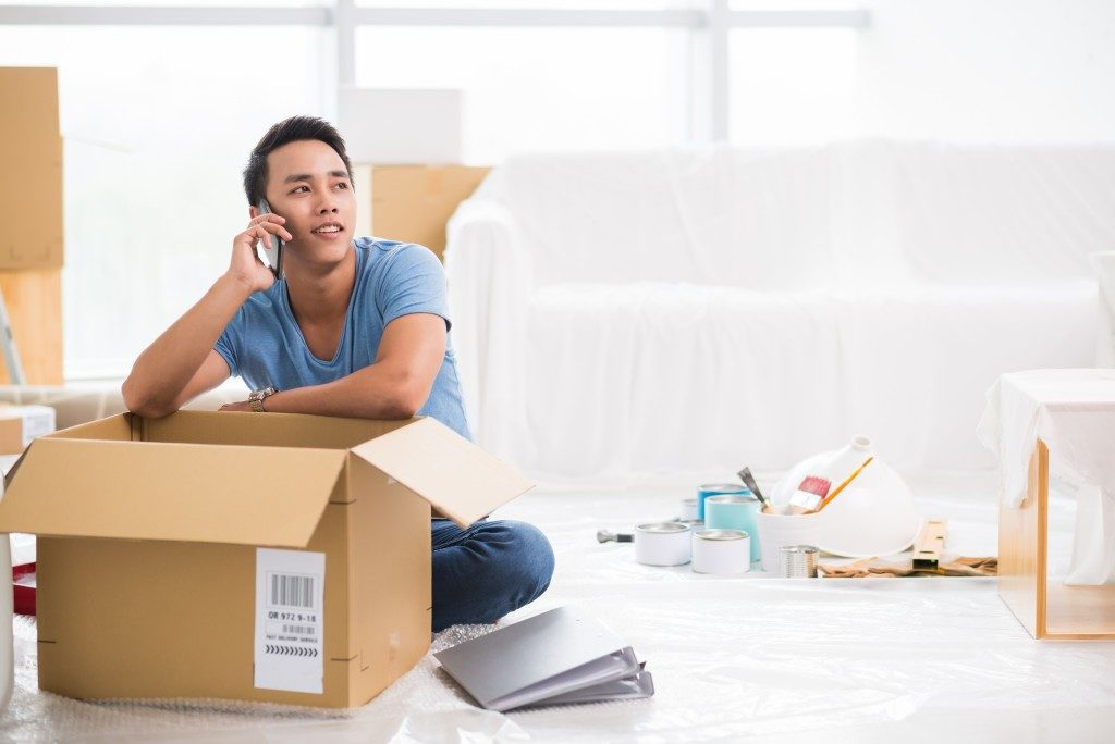 Man talking on the phone while packing