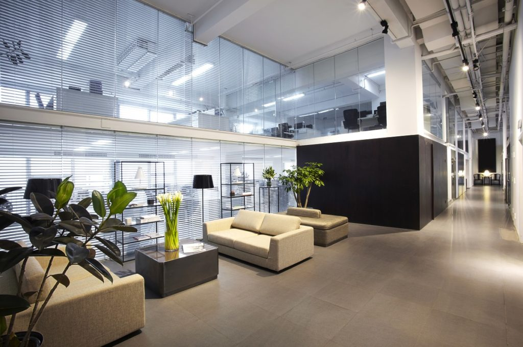 Modern office lobby with plants and couches