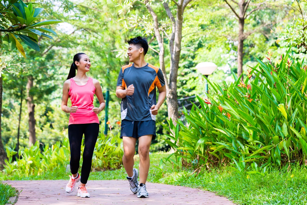 a young couple running