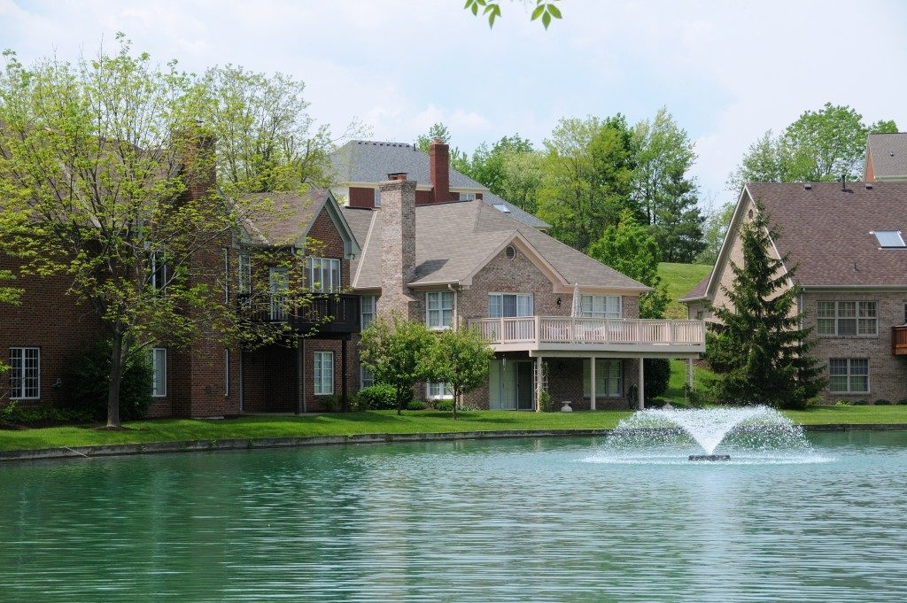 Brick Suburban Lake front Homes in the summer