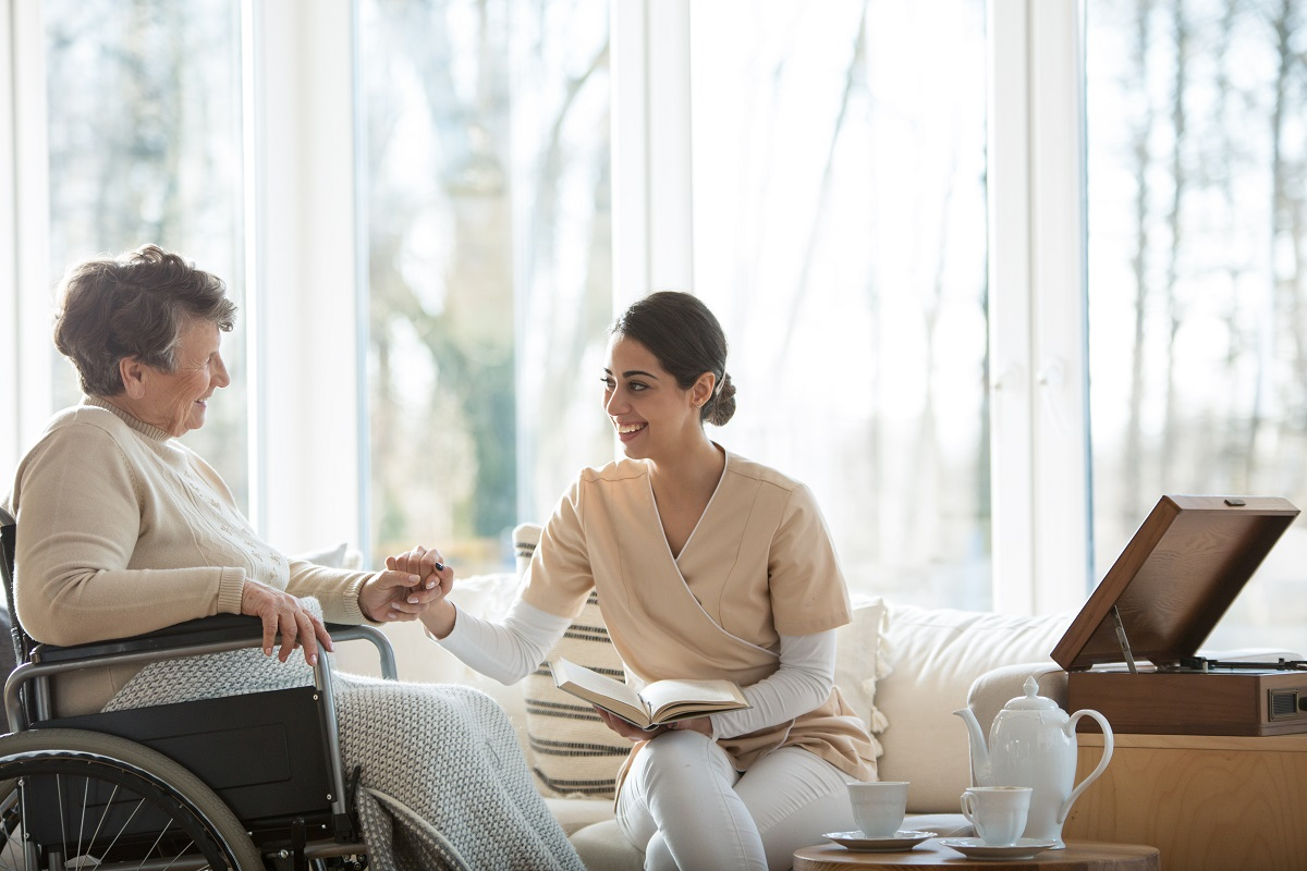 woman talking with a senior
