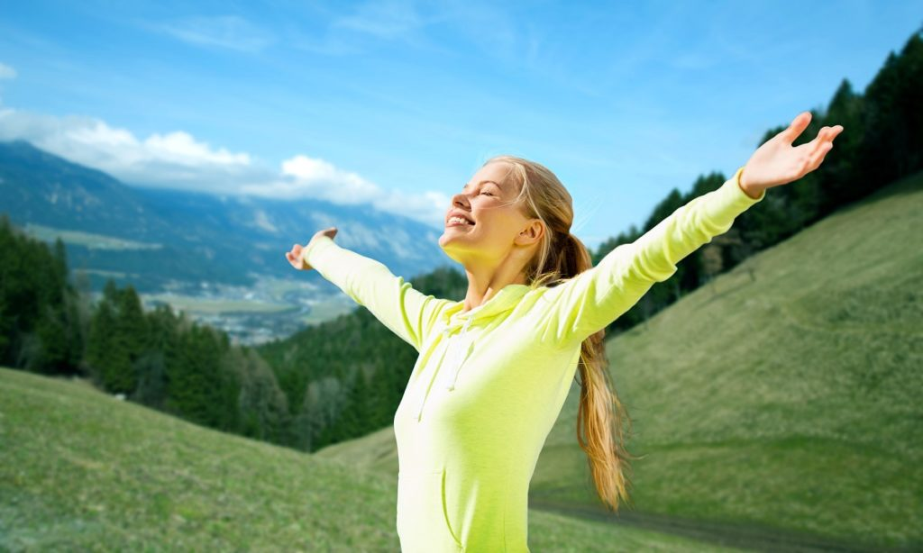 woman having a morning exercise in the mountain
