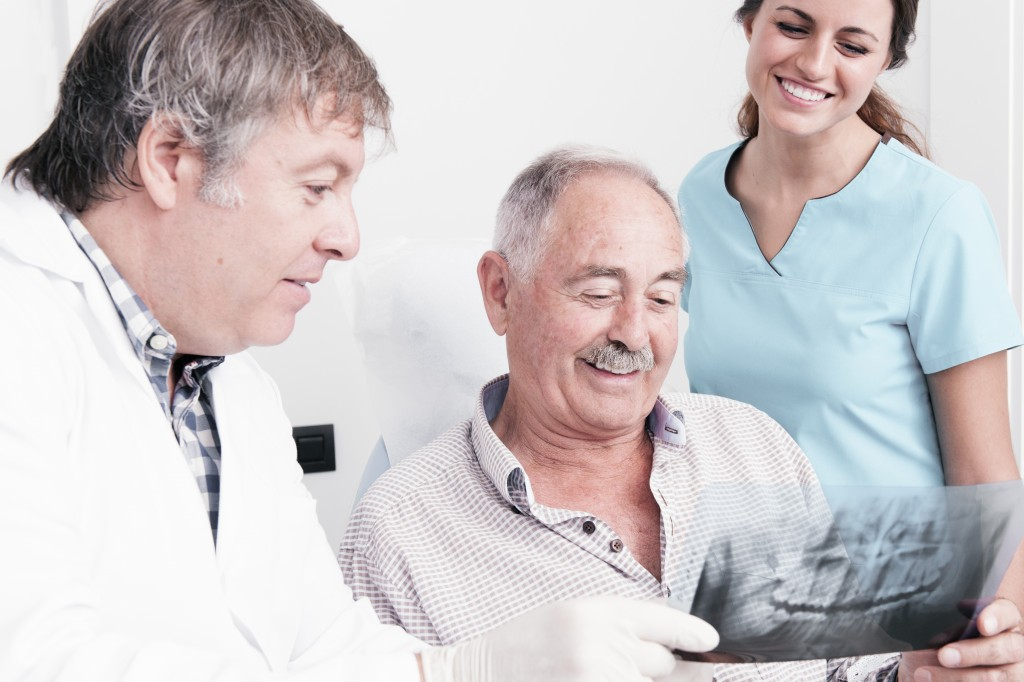 Dentist and old patient