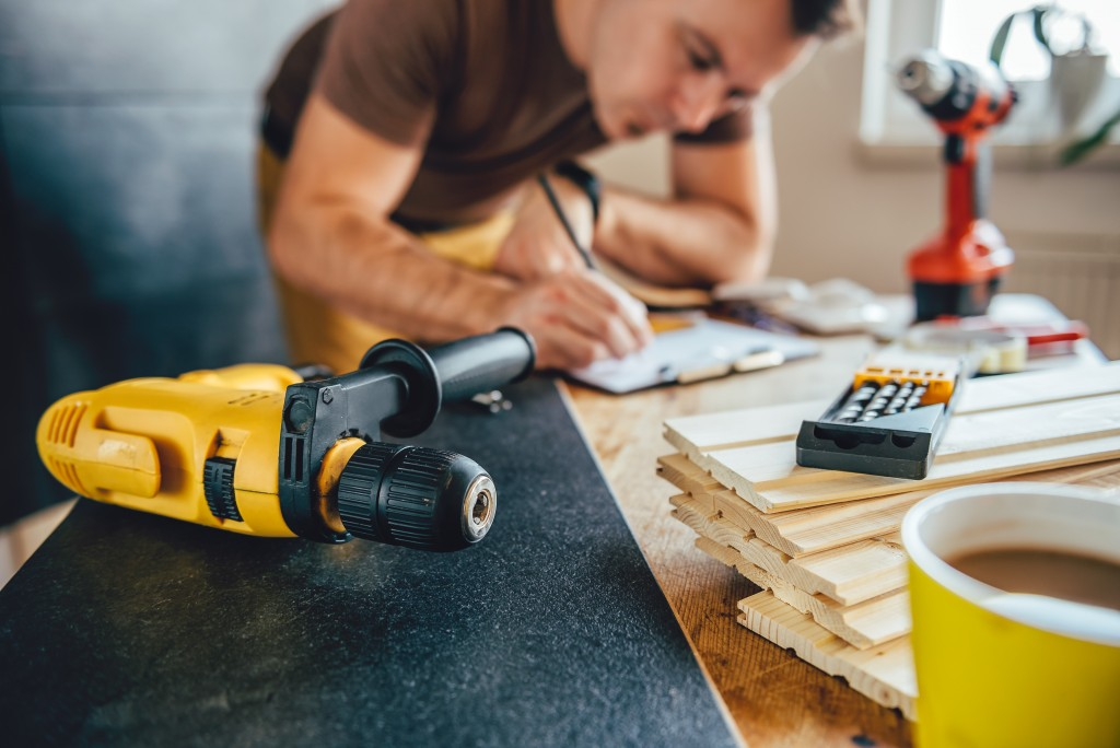 man building a home project