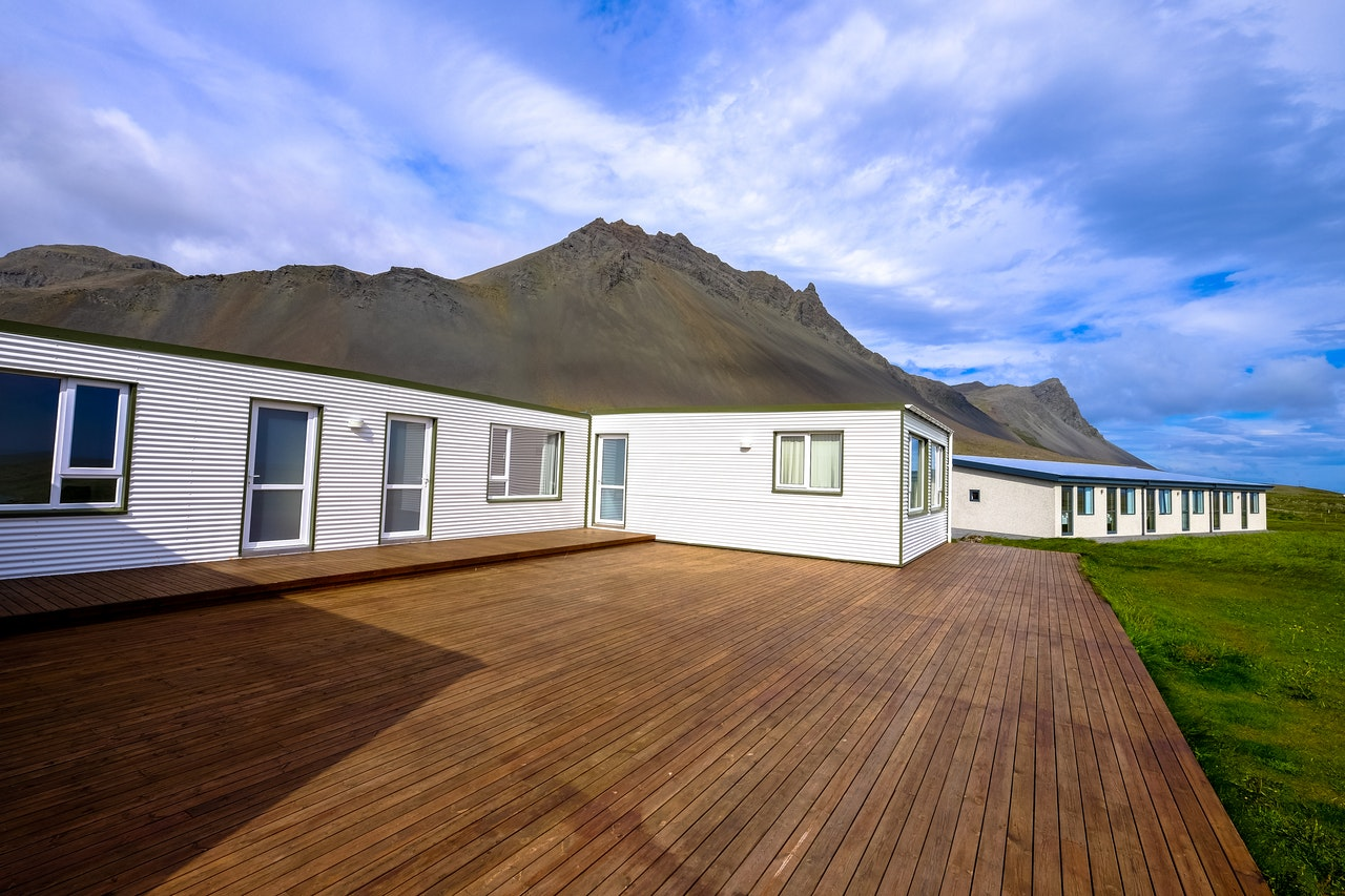 home with a deck near a mountain