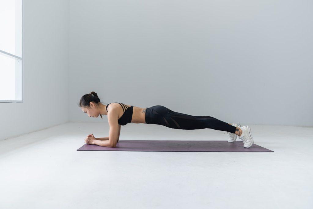 woman doing yoga planking