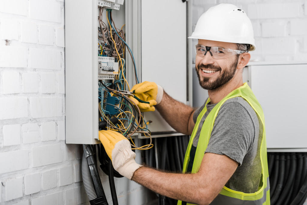 man working on fuse box