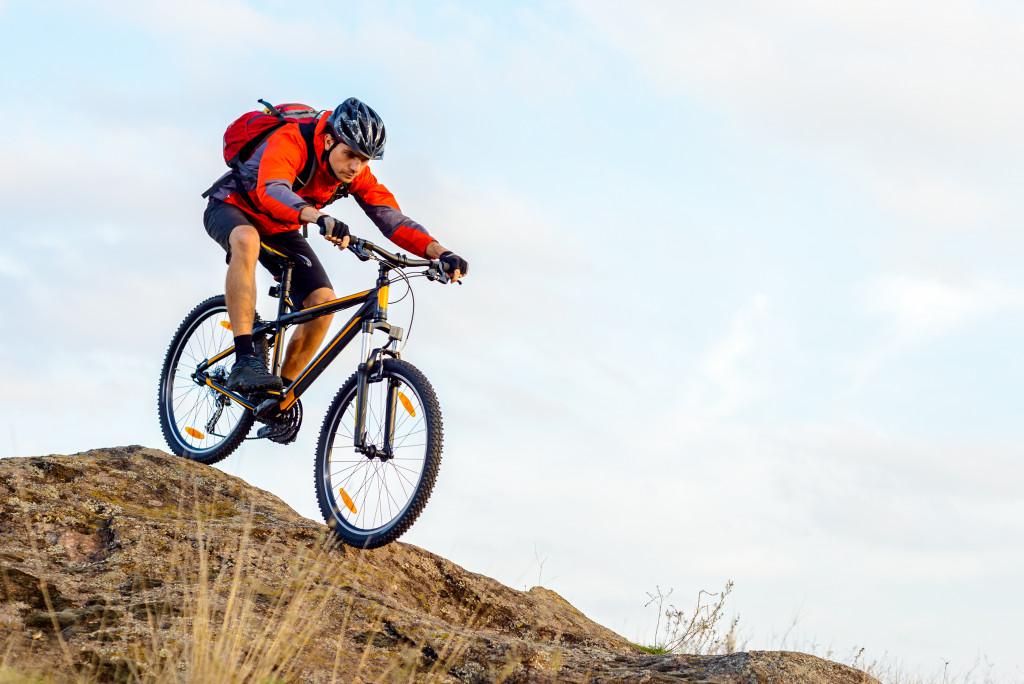 man biking on a mountain