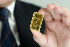 man holding gold