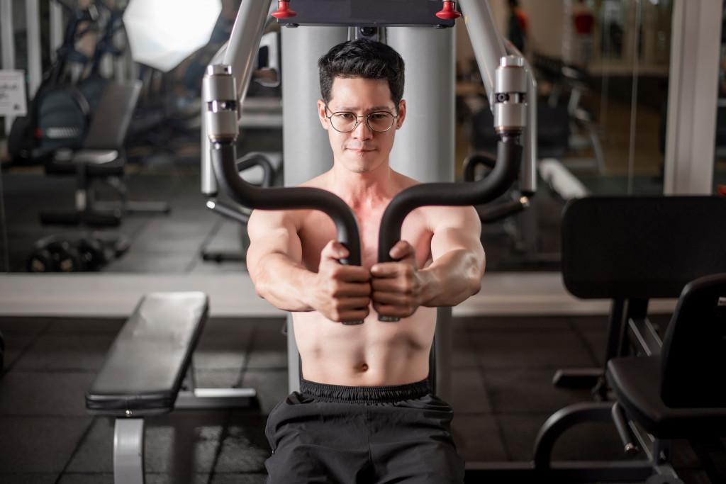 a man using gym equipment