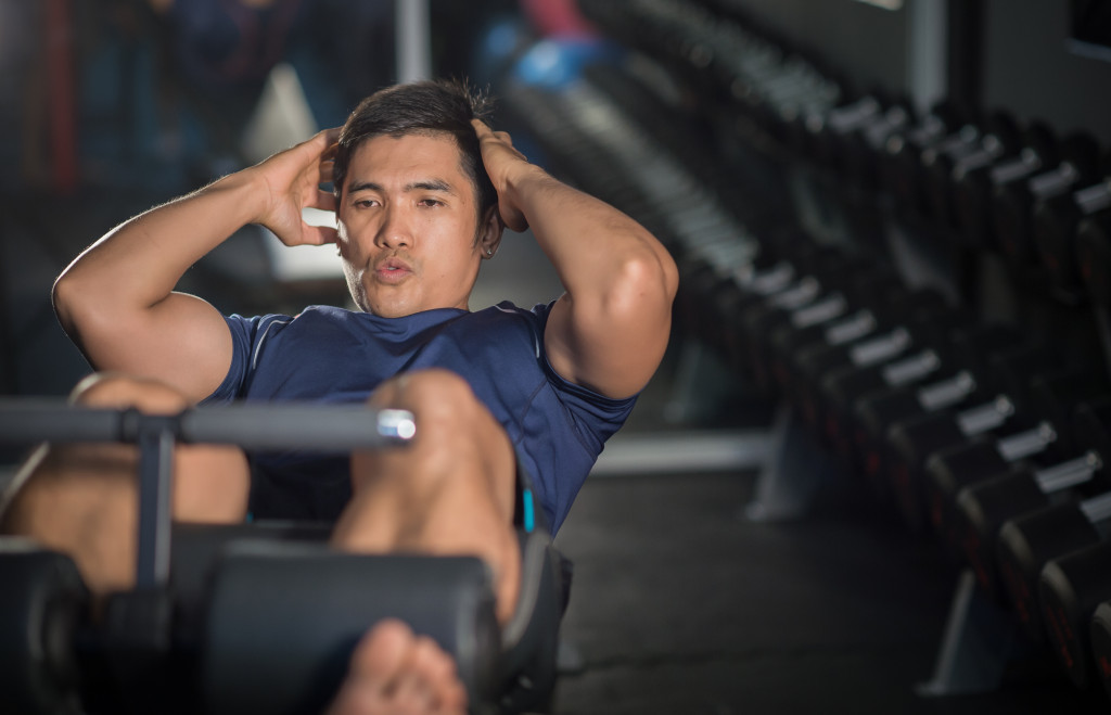 a man doing crunches